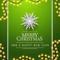 Feliz navidad y próspero año nuevo, postal cuadrada verde con guirnaldas y copos de nieve de papel, vista superior vector