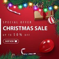 Special offer, Christmas sale, up to 50 off, red square discount banner with garland, Christmas tree, ball, balloon, present and candy can, top view
