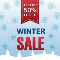 gran cartel de rebajas de invierno con cinta colgando y copos de nieve vector