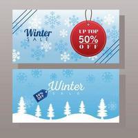 gran cartel de rebajas de invierno con etiquetas colgadas en paisajes nevados vector