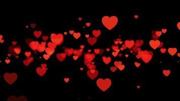 bucle de corazones rojos voladores desde el centro sobre negro