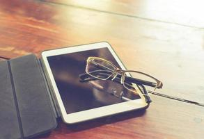 Glasses resting on a tablet