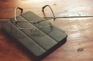 Tablet on table with glasses