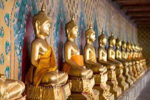 Buddha statues in a temple in Bangkok photo