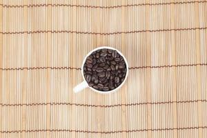 Cup of coffee beans on the table photo