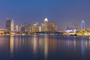 Buildings of Singapore at night photo