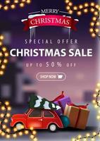 Special offer, Christmas sale, up to 50 off, beautiful discount banner with garland and red vintage car carrying Christmas tree. Vertical discount banner with blurred winter landscape on the background