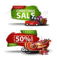 Dos pancartas de descuento navideño en forma de una figura abstracta con bordes irregulares con un coche de época roja con árbol de navidad y trineo de santa con regalos vector