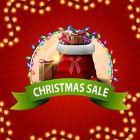 Round Christmas discount banner with green ribbon and Santa Claus bag with gifts. vector