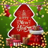 Feliz año nuevo, tarjeta de felicitación cuadrada roja y verde con árbol de navidad cortado de papel, medias navideñas y bolsa roja de santa claus con regalos