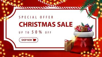 Special offer, Christmas sale, up to 50 off, red discount banner with white paper sheet in the form of vintage ticket, Christmas tree branches, garlands and Santa Claus bag with presents