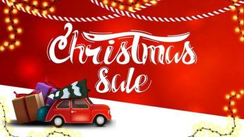 Christmas sale, red discount banner with blurred background, garlands and red vintage car carrying Christmas tree