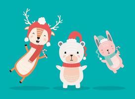 reno con oso polar y conejo con personajes de ropa de navidad vector