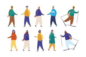 interracial people wearing winter clothes and skiing