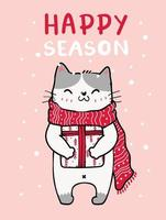 cute cat in a red knitted scarf Christmas with snow falling