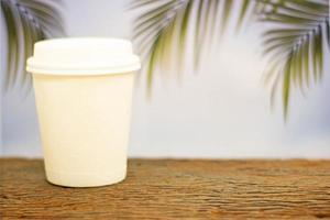 To-go coffee cup with palm trees