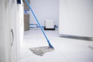 Mop leaning against the wall photo
