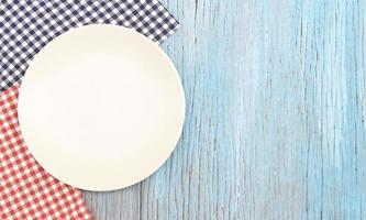 White plate on wood table photo