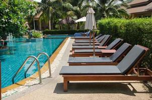 Lounge chairs at a resort swimming pool