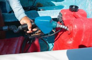 Man fueling motorboat before travel