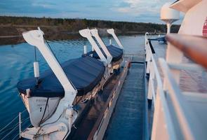 Volga, Russia, 2020 - Rescue boats on cruise liner