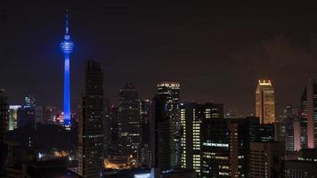 Kuala Lumpur, Malaysia, 2020 - Illuminated city with blue Kuala Lumpur Tower photo