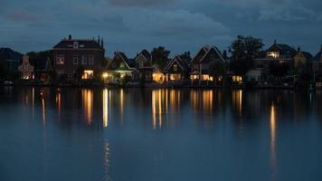 Amsterdam, Netherlands, 2020 -  Reflection of lights on a riverbank photo