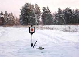 Railway traffic light in snow photo