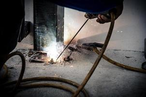 Person welding iron