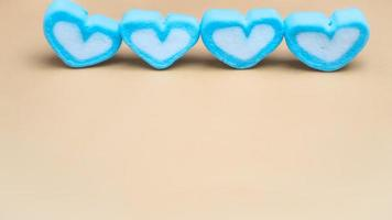 Blue and white marshmallow candies in heart shape
