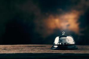 Service bell on dark wooden background