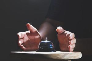 Hands around service bell