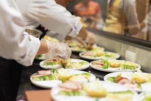 Cooks preparing dishes