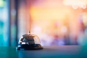 Service bell on colorful bokeh background