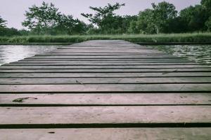 Old wooden foot bridge photo