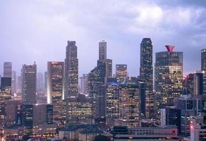 Buildings of Singapore city at night photo
