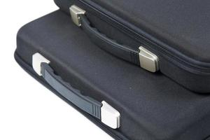 Black briefcases on white background photo