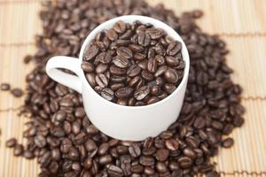 Coffee beans in a coffee cup photo