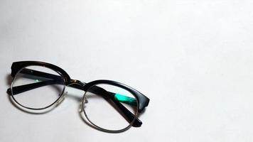 Folded glasses on white background