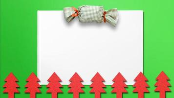 Christmas tree cut-outs with candy and white paper for Christmas background