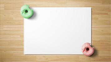 Green and red donuts on white paper on wooden background