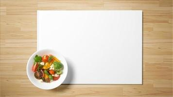 Fruit salad on white paper on wooden background