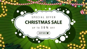 Special offer, Christmas sale, up to 50 off, modern green discount banner in graffiti style with Christmas decor