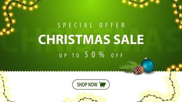 Christmas sale, up to 50 off, green bright horizontal modern web banner for website with button, garland and Christmas tree branch