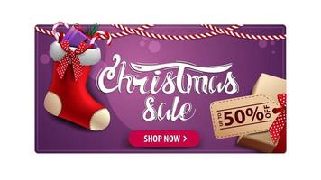 Christmas sale, purple discount card with gift with price tag and Christmas stockings vector