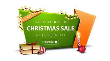 Special offer, Christmas sale, up to 50 off, green discount banner in cartoon style with garland, Christmas books, candle, Christmas ball and cone vector