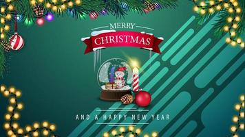 Merry Christmas and Happy New Year, green horizontal postcard with snow globe, garland and Christmas tree branch