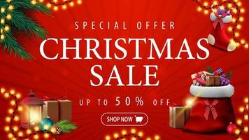 Special offer, Christmas sale, up to 50 off, red discount banner with garland, Christmas tree branches, Christmas stocking and red Santa Claus bag with presents