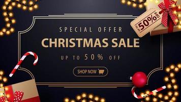 oferta especial, venta de navidad, hasta 50 de descuento, banner de descuento azul oscuro con guirnalda, marco dorado vintage y regalos, vista superior vector