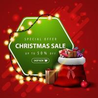 Special offer, Christmas sale, up to 50 off, square red and green banner with garland and Santa Claus bag with presents